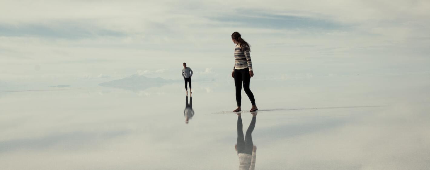 Couple walking on white sand