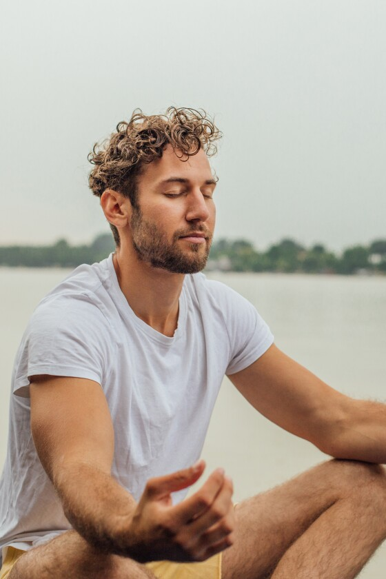 Fit man sitting in yoga pose