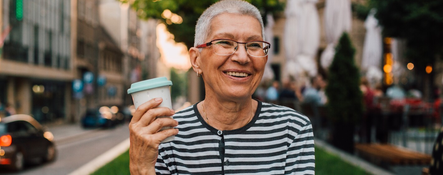 Senior woman enjoying her coffee in the city