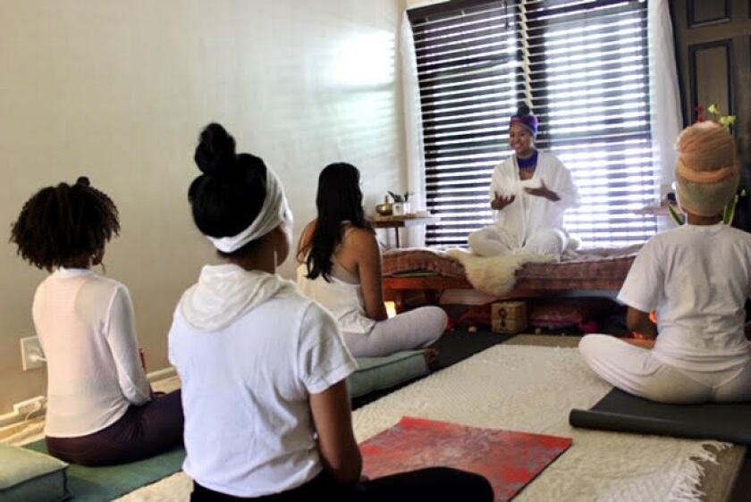 Teacher leading meditation