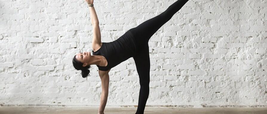 woman doing yoga half moon pose