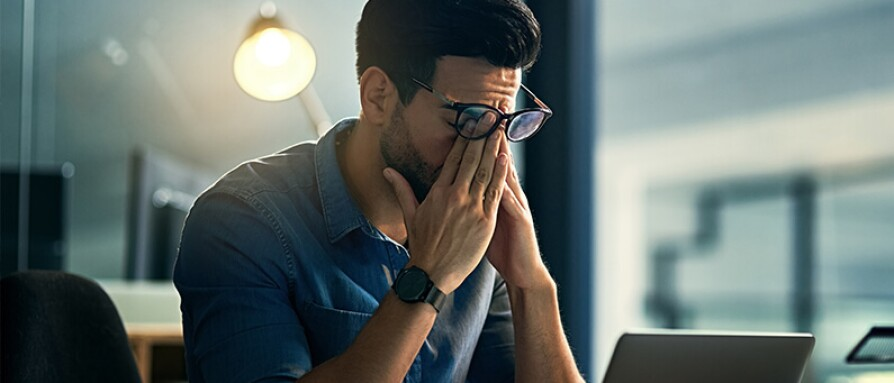 man frustrated working late