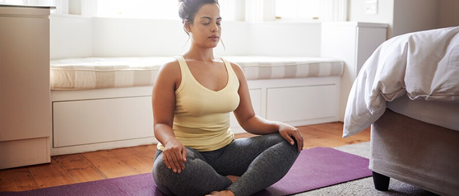 woman meditating at home