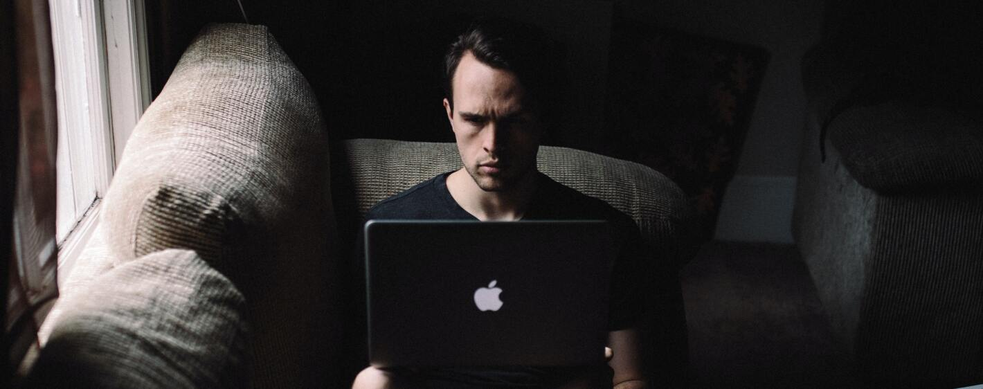 Guy in shadow with laptop