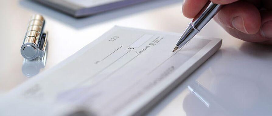 Writing a check to create abundance