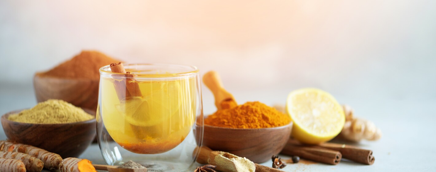 A mix of warming spices next to a glass cup