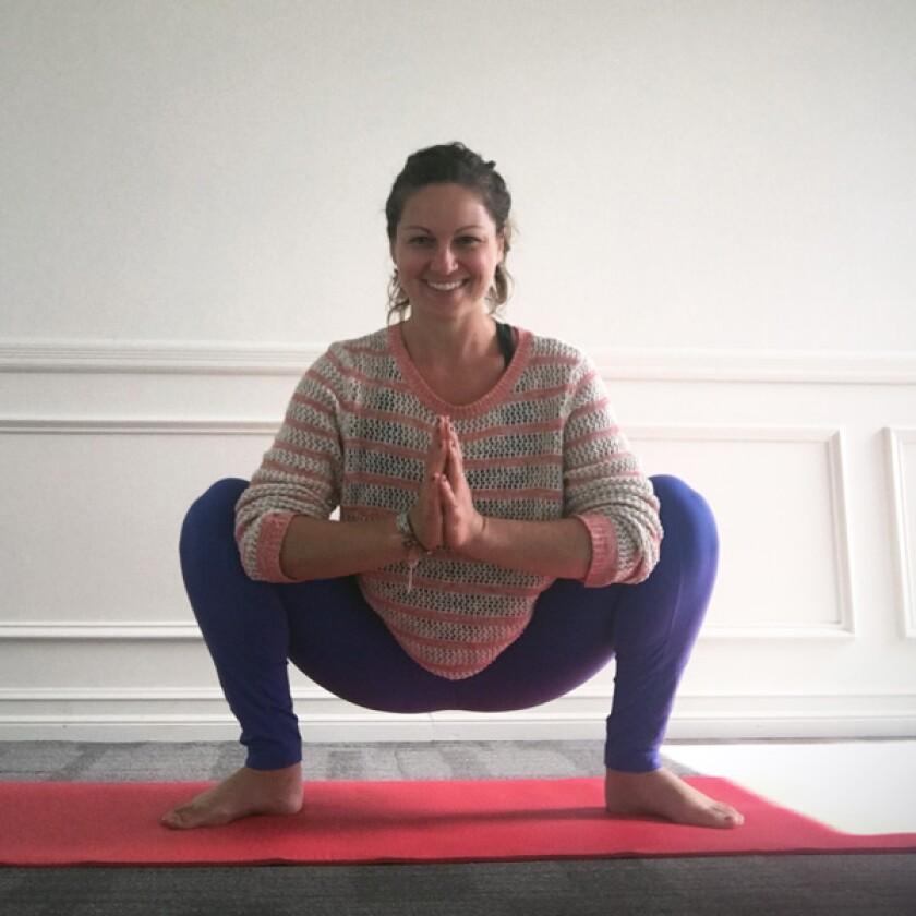Yoga teacher in frog's pose