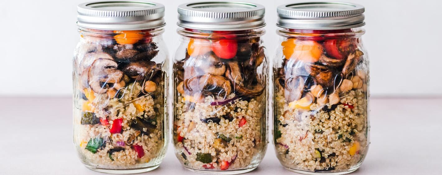 Mason jars with quinoa and veggies iron