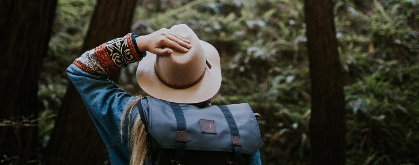 Girl with a hat hiking