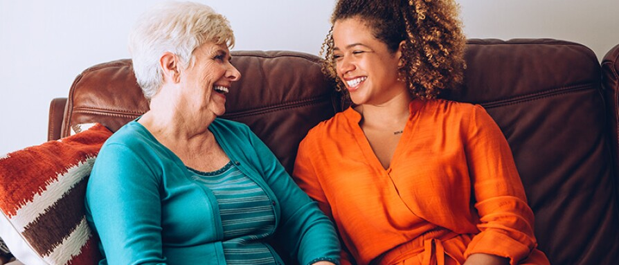 two women laughing authentic