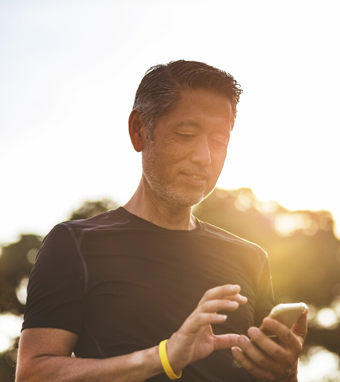 A man holding a phone outdoors