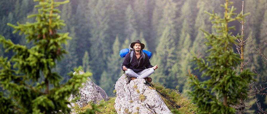 man hiking meditation in mountain