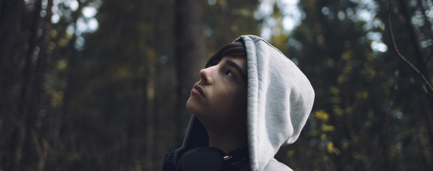Guy with a hoodie in the forest