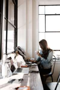 Woman sitting at her desk working on her laptop