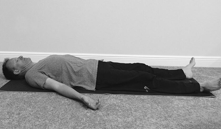 Man in corpse yoga pose