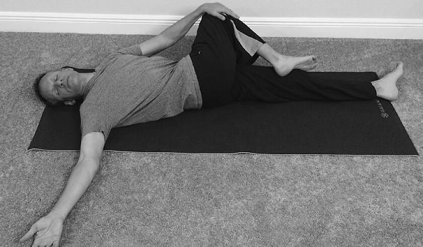Man in knee down twist yoga pose