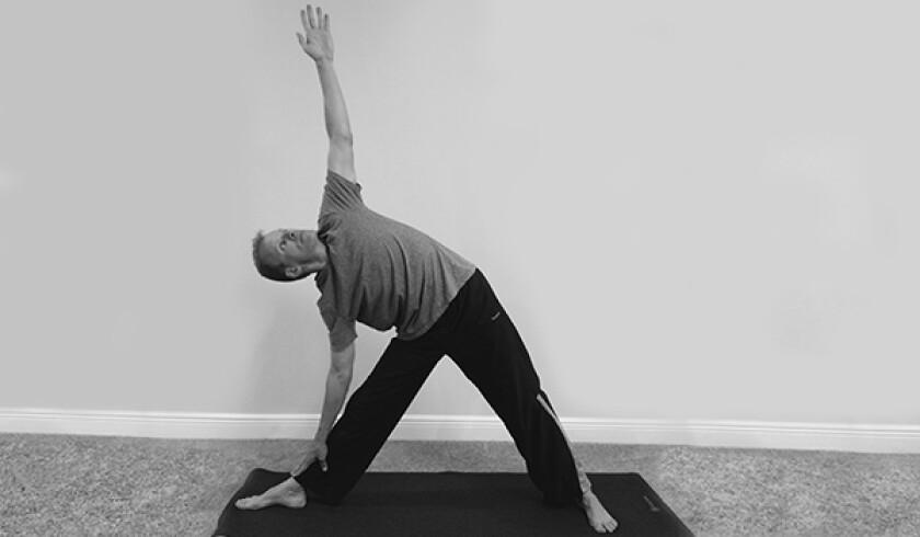 Man in triangle yoga pose