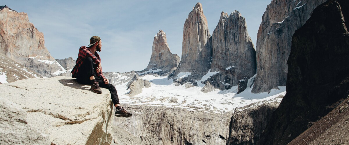 Man is looking at scenic view of Torres del Paine National Park
