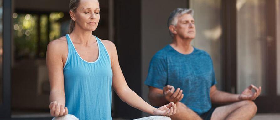 mature woman and man meditating