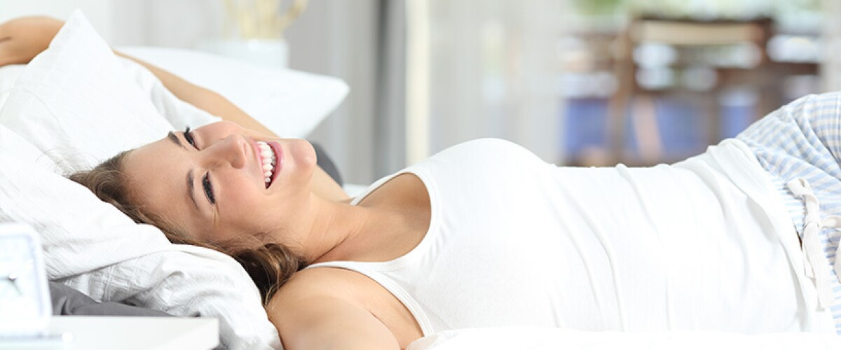 Woman stretching in bed
