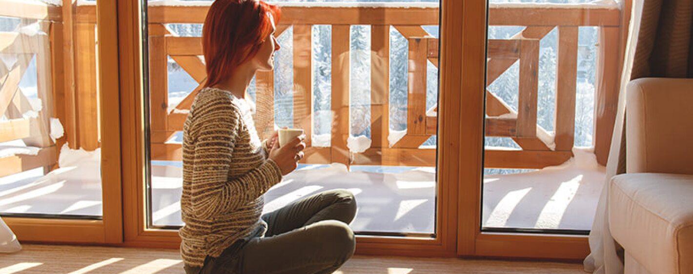 woman enjoying coffee in cabin