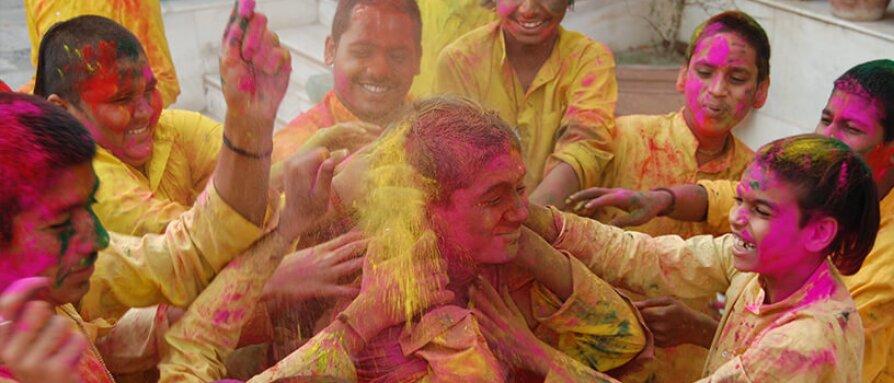 Kids celebrating holi festival of colors in India
