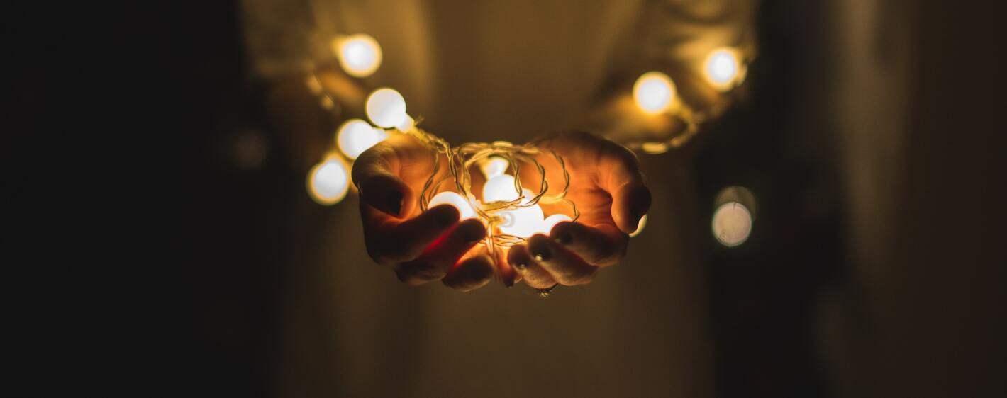 Holiday lights in palm of hands