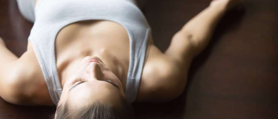 woman in grey deep breath pranayama