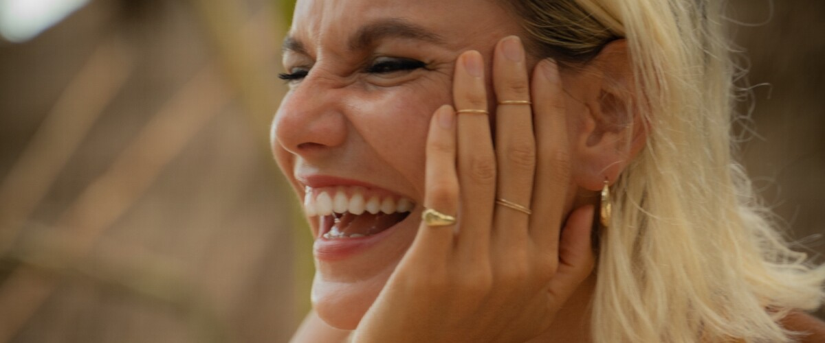 A young woman laughing
