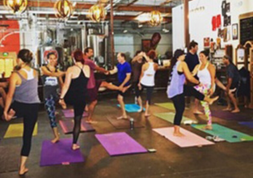group doing yoga at brewery