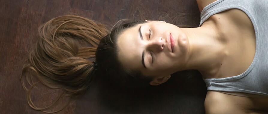 woman savasana yoga