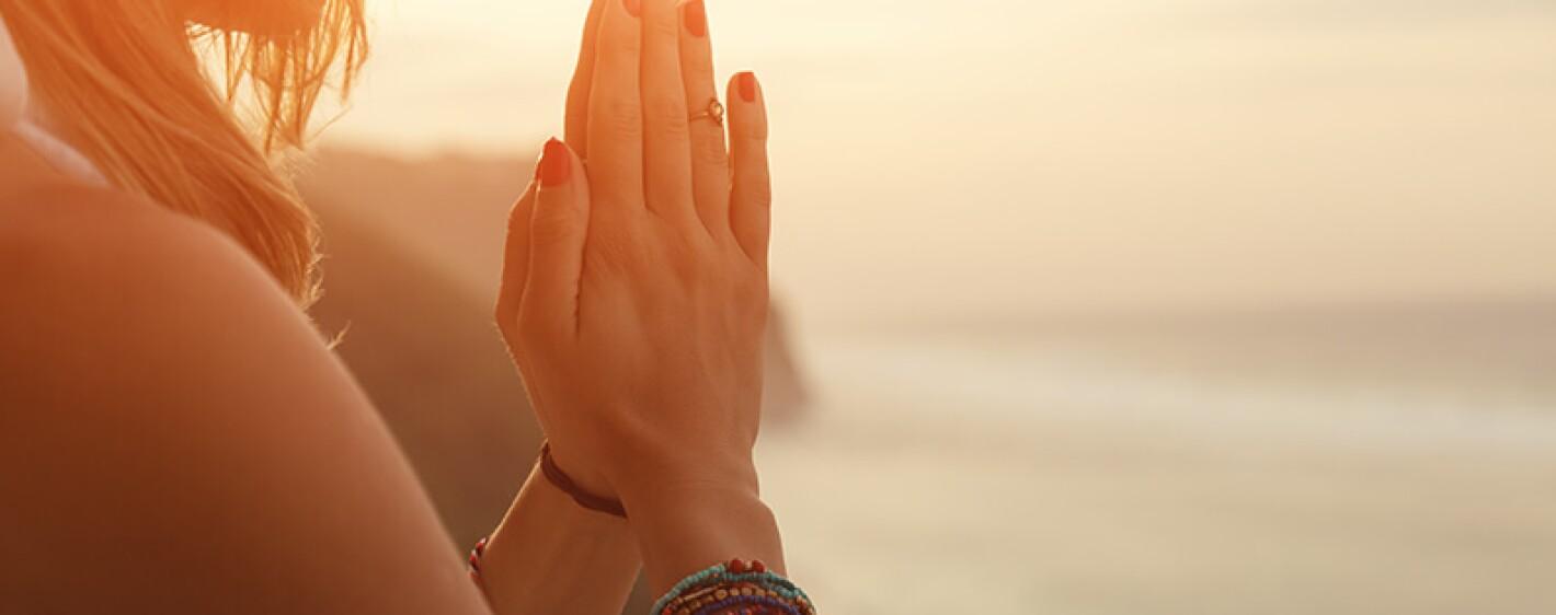 prayer hands namasté heart center