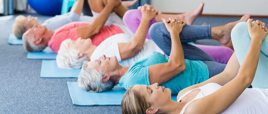 seniors taking yoga class