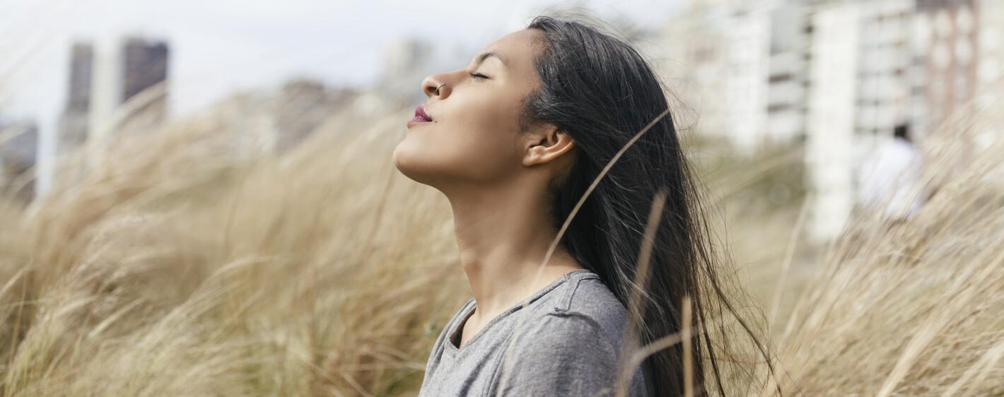 Bolivian girl meditating on high pastures