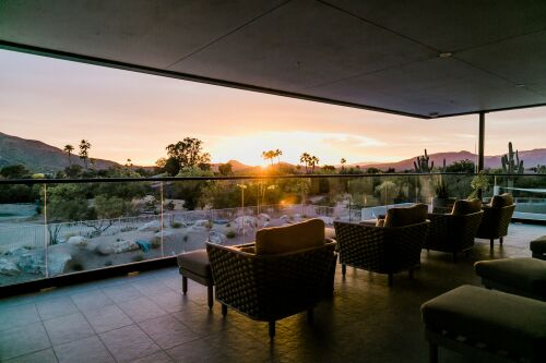 A patio overlooking resort at sunset