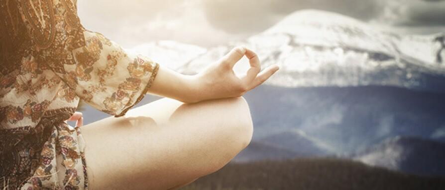 woman sitting in lotus pose meditating