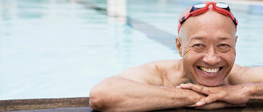 cheerful man in swimming pool