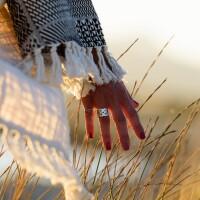 Woman hand caressing grass