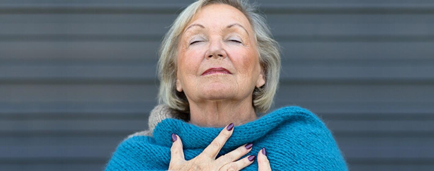 mature woman taking a deep breath