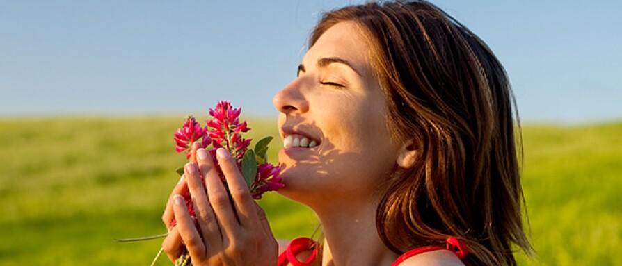 womaninfieldwithflowers.jpg