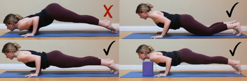 A yoga teacher in Chaturanga Dandasana yoga pose