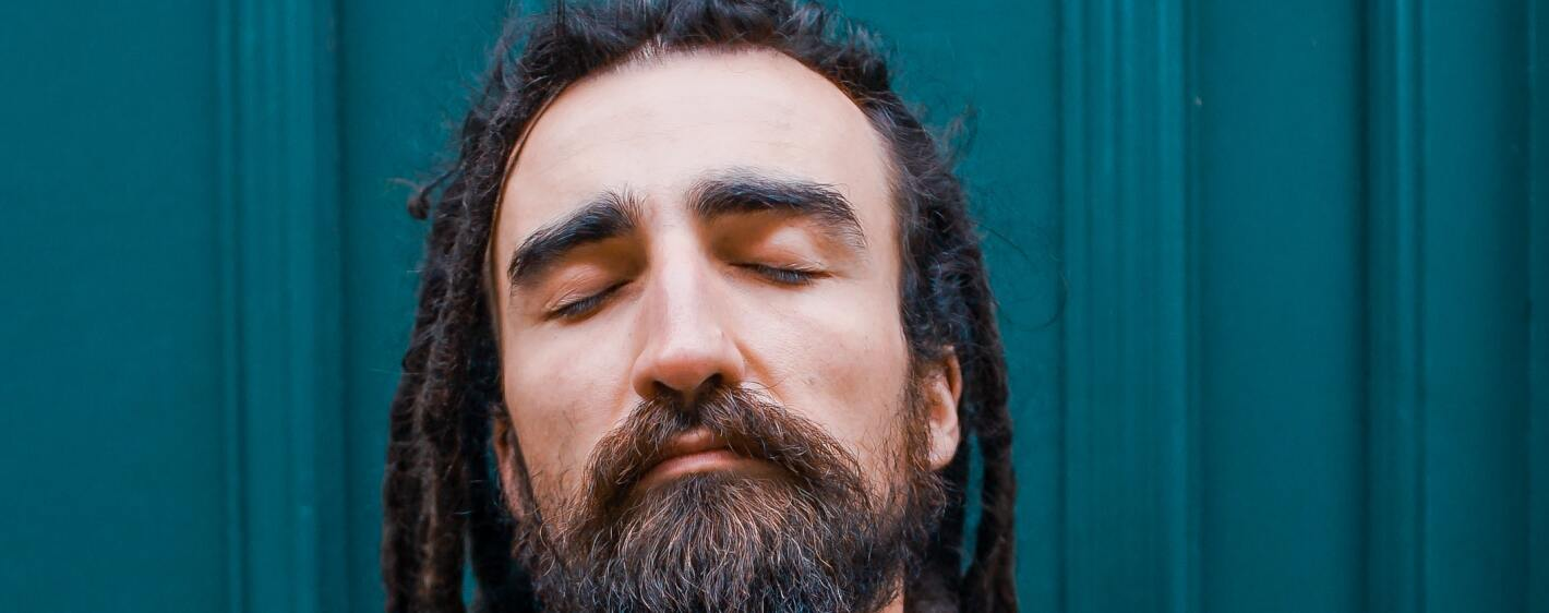 A man relaxing with his eyes closed