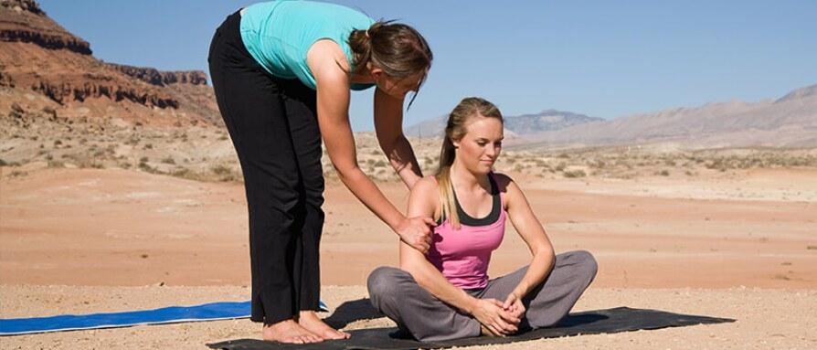 woman teaching yoga in desert
