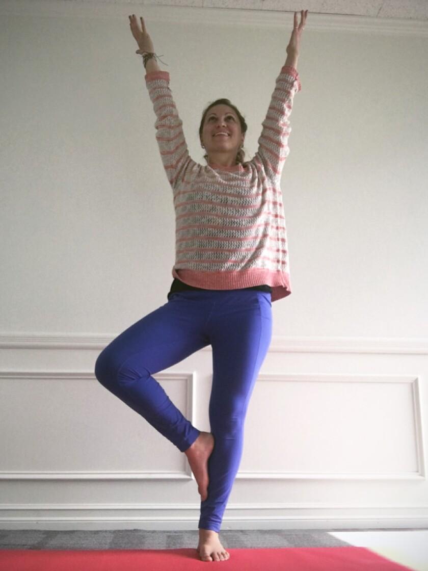 Yoga teacher in tree pose