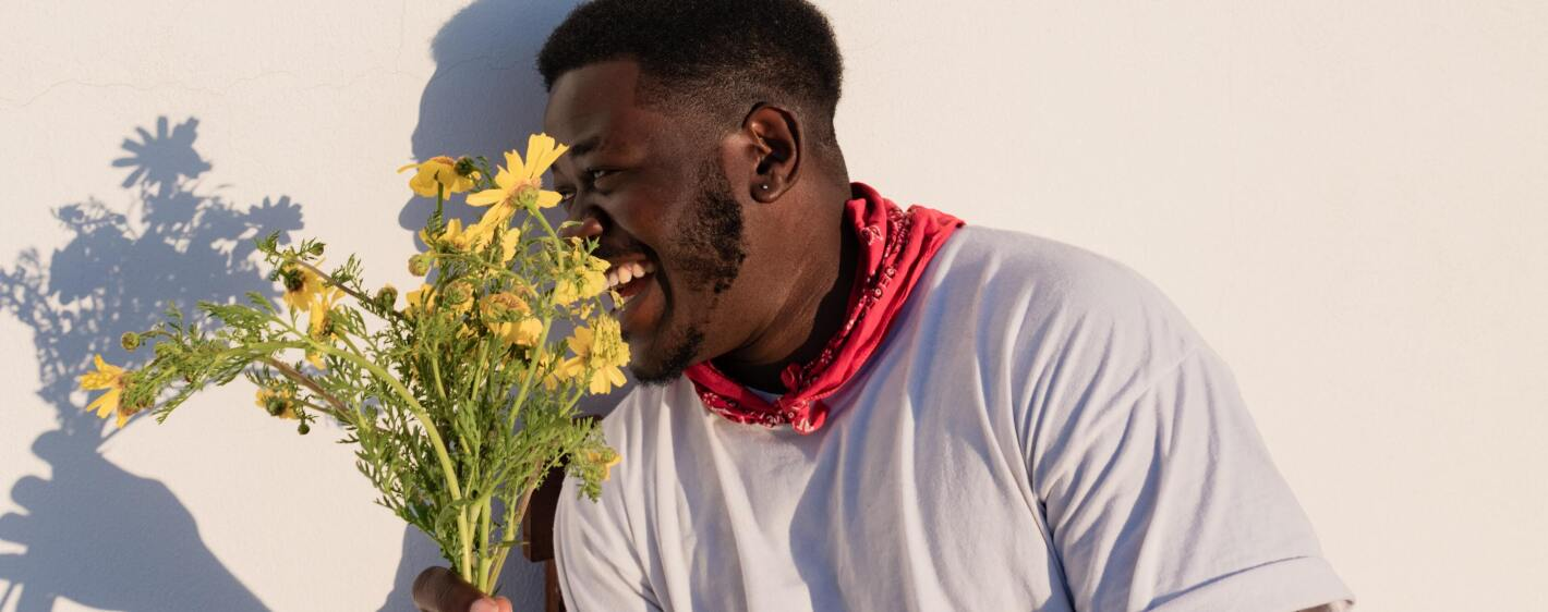 Smiling man with flowers