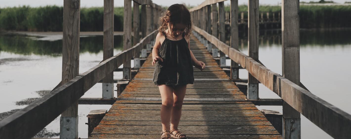 Little girl on wooden deck
