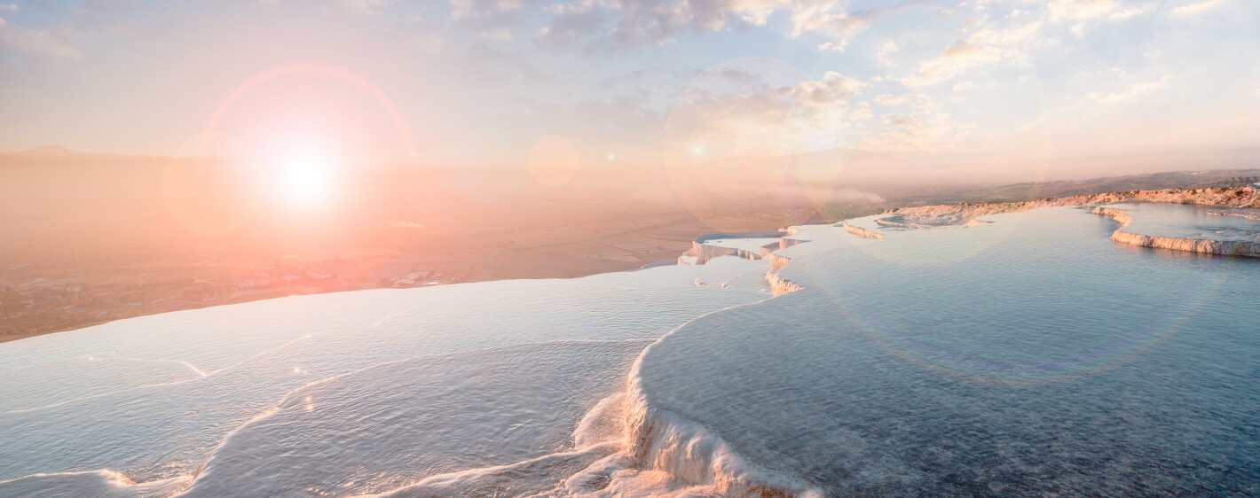 Beautiful scenic view of travertine pools during sunset in Pamukkale in Turkey