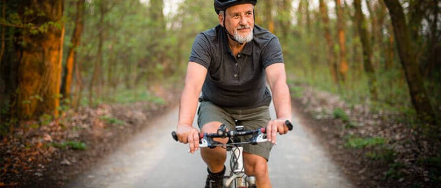 senior man riding bicycle healthy lifestyle