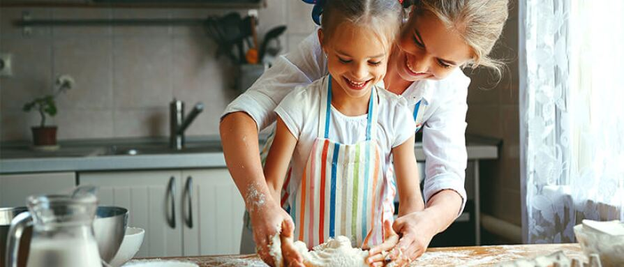 mother and daughter baking joy love