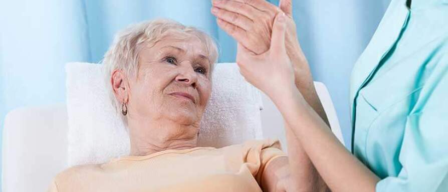 An elderly woman with arm pain examined at the hospital